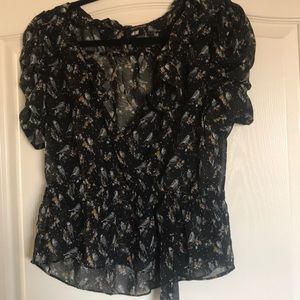 Bird print ruffle trim blouse.